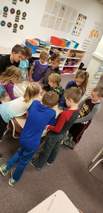 Miss Peters' Kindergarten class working together practicing sentence building.