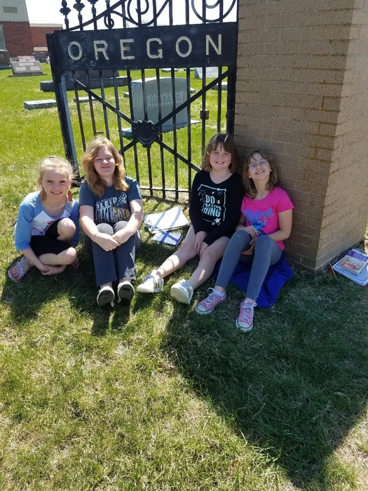 Mrs. Knapp's class enjoying reading in the nice weather!