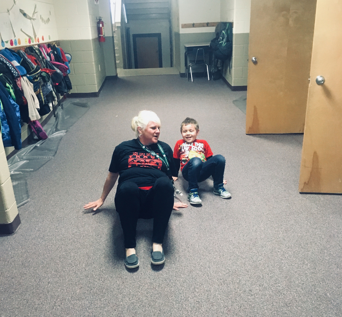 Mrs. Grove is helping a Kindergarten kiddo get his wiggles out before testing today.