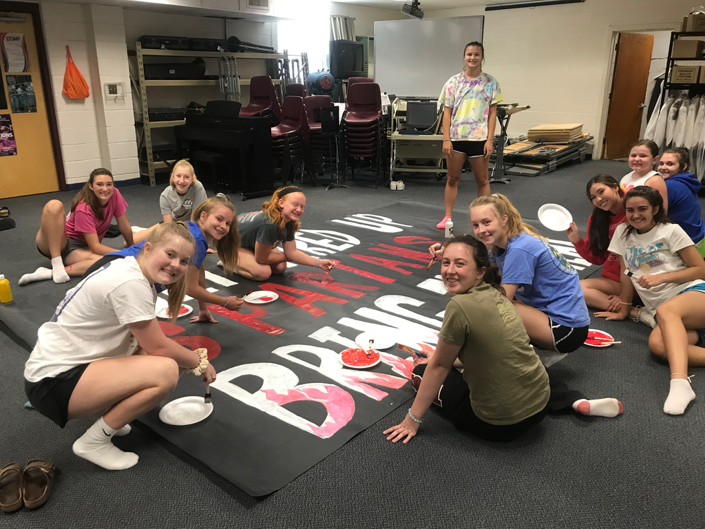 Spartan Cheerleaders working hard and starting on banners for football. Go Spartans!