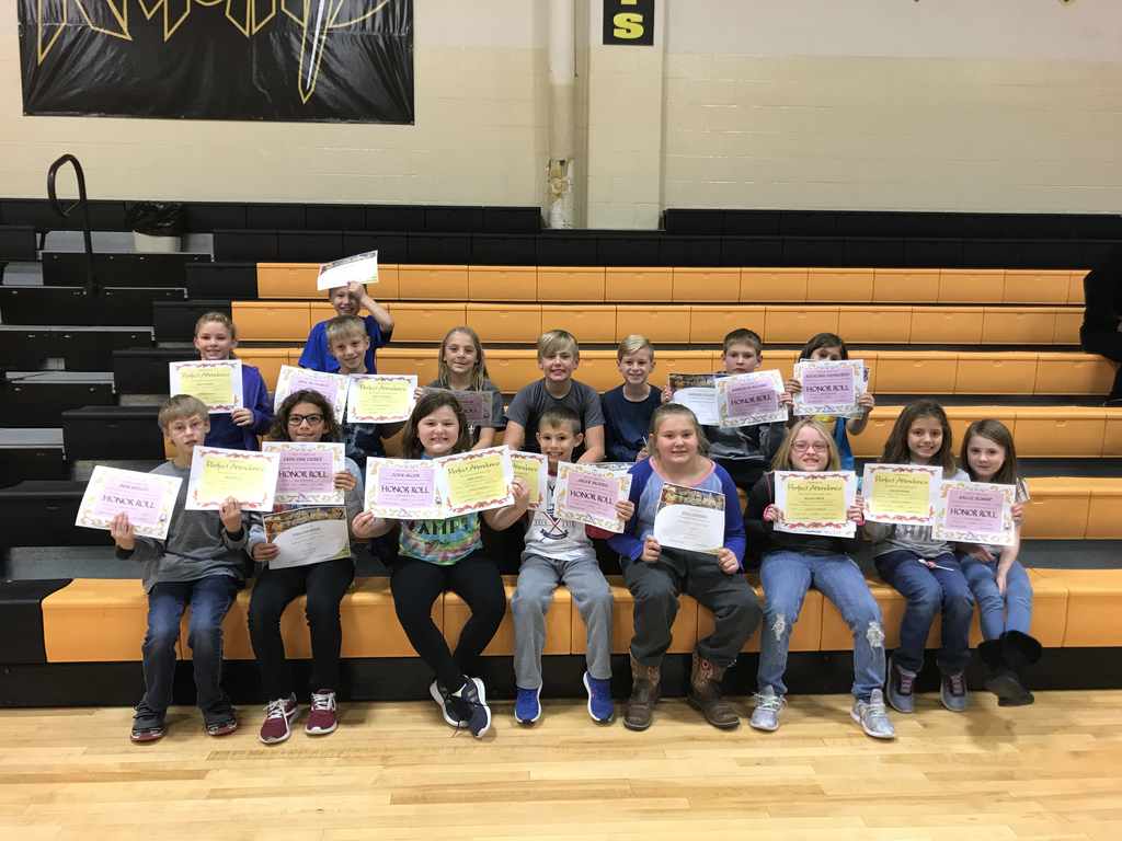 Third graders proudly displaying awards from First Quarter for Honor Roll and attendance