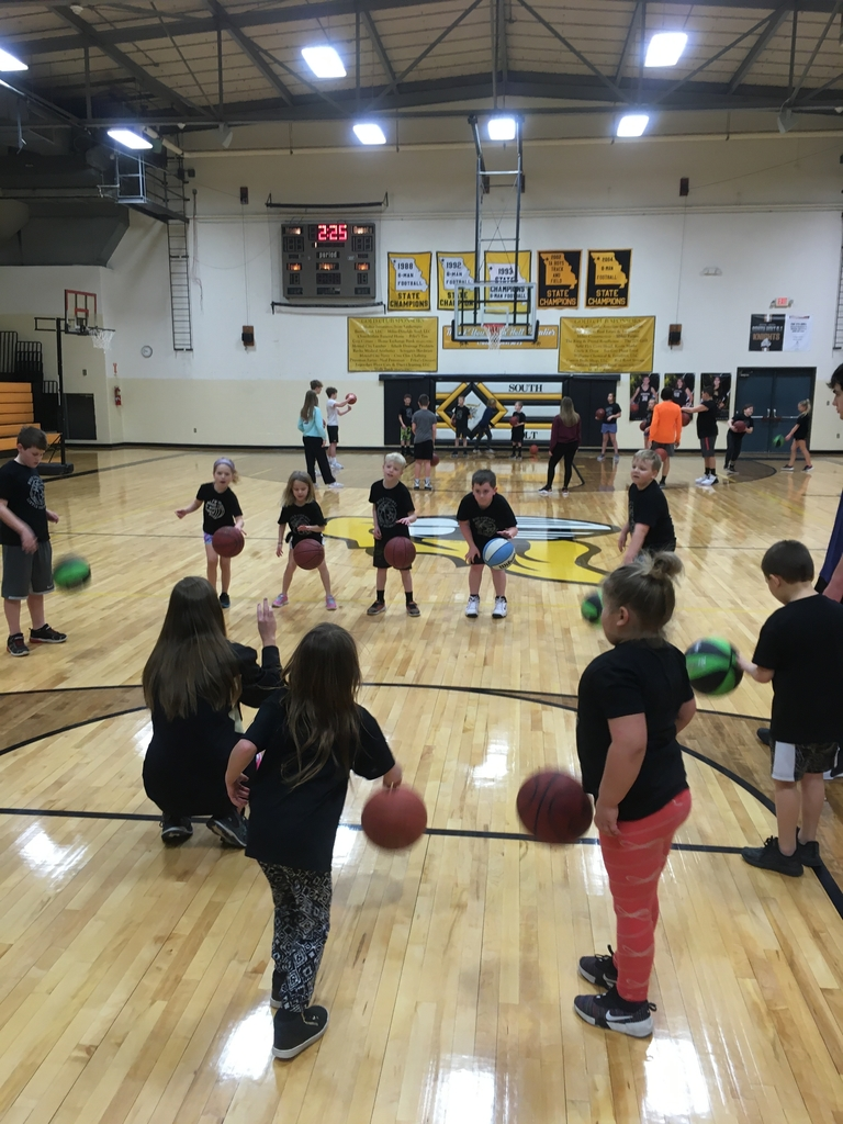 First and second graders working on dribbling